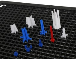 Rotatable pins for Techray and Variogrid trays